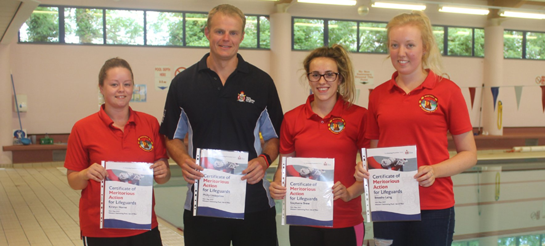 Local lifeguards honoured for saving woman's life