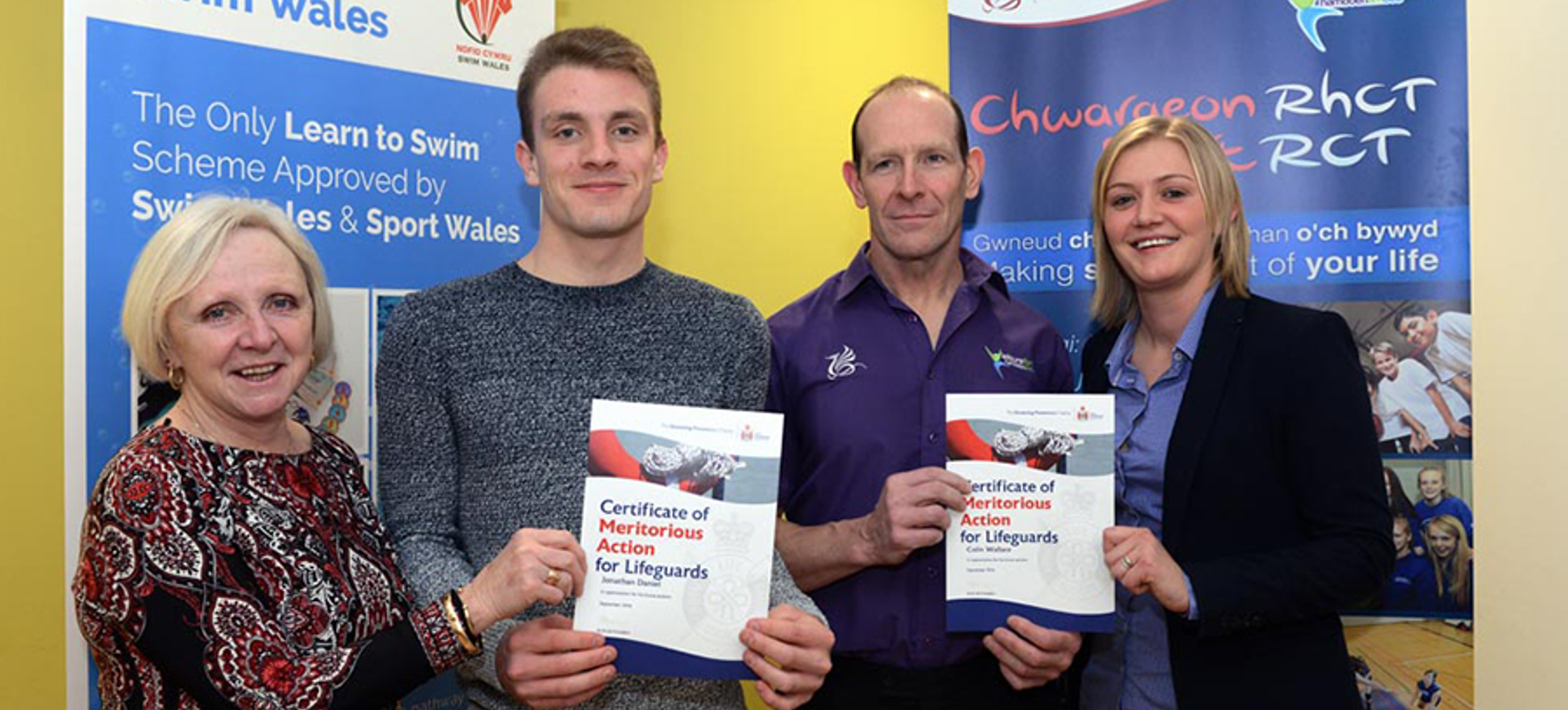 Two Aberdare lifeguards have received a national award after helping to save the life of a local football player.
